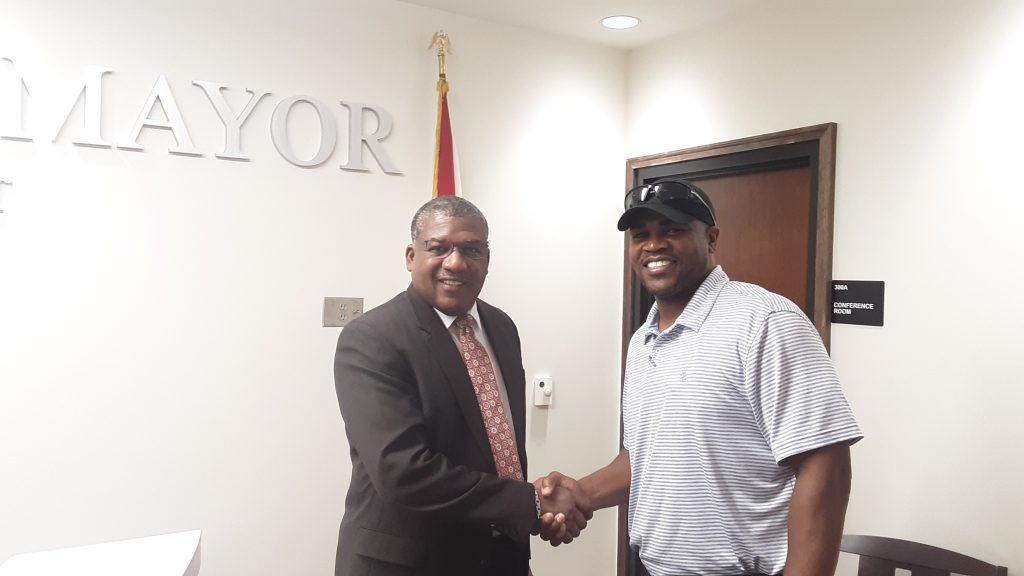 Bessemer Mayor Kenneth Gulley (left) meets with new Bessemer City High School head football coach Andrew Zow.