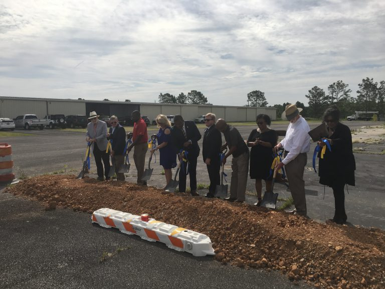 Officials from the city of Bessemer, the Bessemer Airport Authority, Jefferson County, ALDOT and Cadence Bank break ground on a $750,000 hangar project on Tuesday, June 25, 2019 at the Bessemer Municipal Airport.