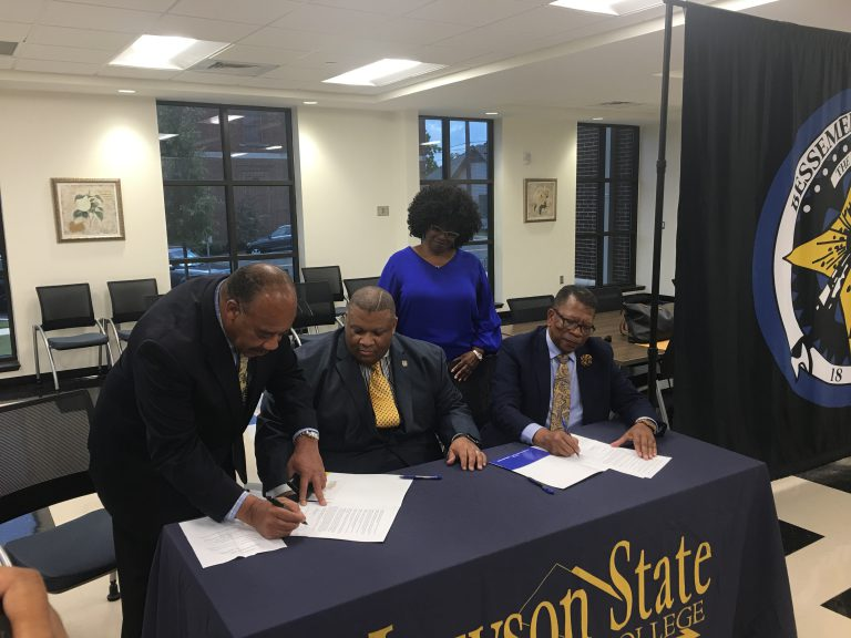 Municipal Court Judge Aaron Killings (left) and Vice VP of Instructional Services for Lawson State Dr. Bruce Crawford (far right) sign a memorandum of understanding for the A.B.C. initiative on Thursday, August 1, 2019 at Bessemer City Hall while Chief Magistrate Dr. Maurice Muhammad (middle seated) and Chief Court Clerk Gwen Horn (standing) look on.