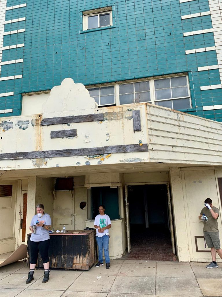 Volunteers from the Bessemer Historic Society help clean the Lincoln Theater