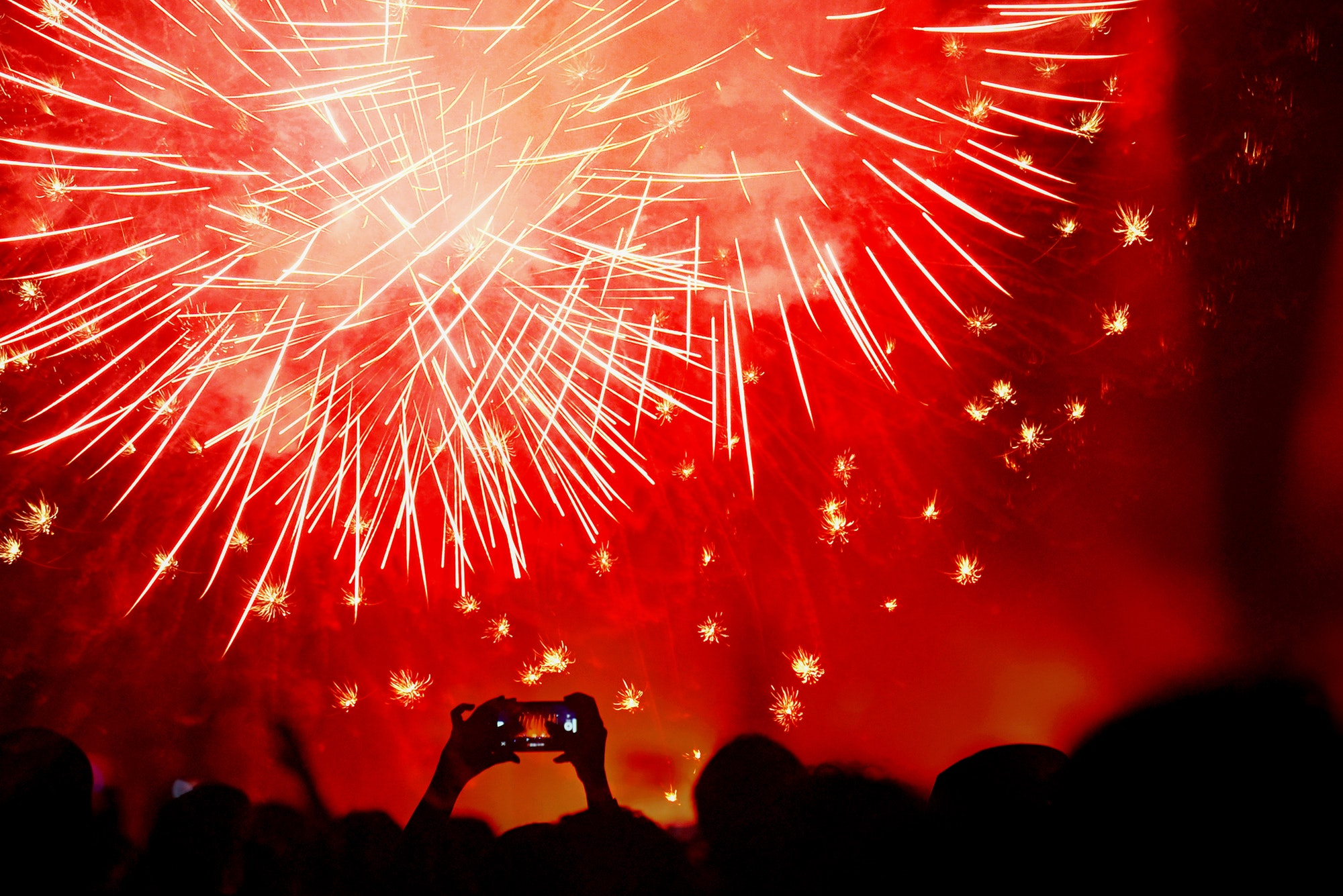 Crowd celebrating the New Year with fireworks, New Year concept