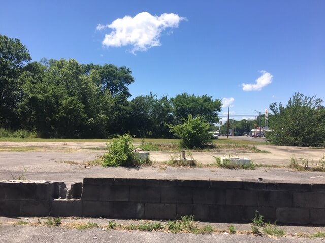 abandoned gas station site on Eighth Avenue North in Bessemer
